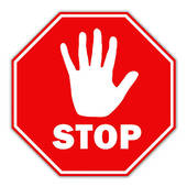 Stop sign with a raised hand in the middle